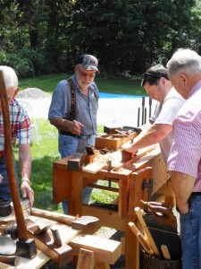 Mark Johnston demonstrates how to properly use an old tool at a talk at the Ames-Florida-Stork House in Rockford earlier this year. Photo by Karen Flaten
