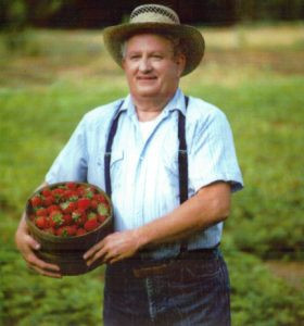 Bill posed for this Cub Foods billboard. He is carrying a wooden pail of strawberries to promote fresh produce. Photo contributed.