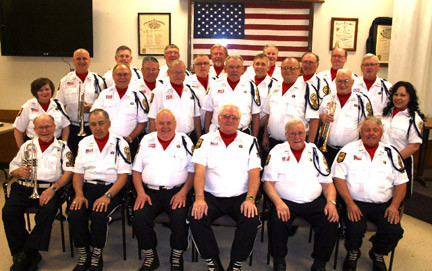 The Hutchinson Memorial Rifle Squad with the original members sitting in the front row, from the left, Wally Pikal, Chaplain/Assistant Commander Robert Rolander, Commander Sam Flom, Dave Neubarth, Chuck Burich and Ron Swenson. Second row, Coordinator Dee Koepp, Ed Homan, Norb Mohs, Bill Baumann, Phil Trebelhorn, Larry Roepke and Assistant Coordinator Mara Koepp. Third row: Randy Damman, Assistant Quartermaster Jerry Tews, Assistant Commander Paul Doelger, Steve Brown, Leon Pesina and Quartermaster Spencer Beytien. Back row: Roger Mies, Larry Hoff, Dave Skoog, Marc Bailey and Duane Arndt.