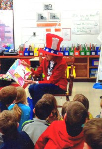 Lois Hultberg enjoys reading to students in local schools. She is pictured here reading to first-graders at Pinewood Elementary in Monticello.