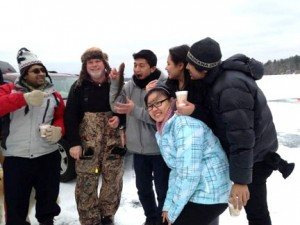Little Falls Friends volunteer Mark Gilbert ice fishing with international students from St. Cloud State. Most international students never get this opportunity.   Photo by Lois Hokanson
