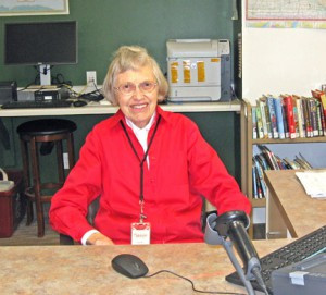 "Lois Hultberg, who hopes to substitute at each one of the branches of the Great River Regional Library system, is pictured at the Royalton Library. Her life is busy with a rich variety of activities, and Lois takes her smile everywhere as an unofficial ""smile-a-lyzer."" Contributed photo"