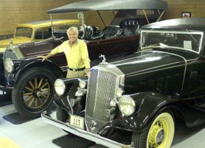 Curt Sampson with three of his antique cars. On the far left is a 1933 Chevy and then the 1915 Pierce-Arrow followed by a 1933 Pierce Arrow. He has nearly 40 antique cars in his collection. Photo contributed.