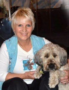 Nancy Starewicz and her dog, Lucky, a Wheaten terrier, have visited with thousands of  students, teaching them about good behavior. Contributed photo