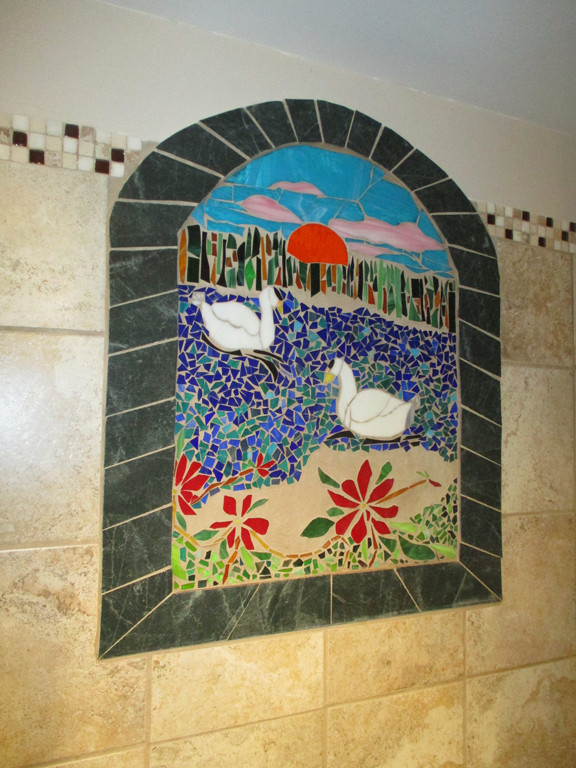 In the basement shower, Roxanne put in a stained glass and tile mosaic. Photos by Jennie Zeitler