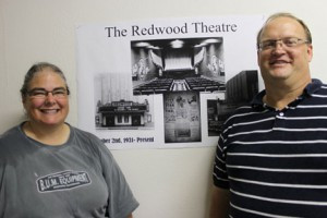 Cindy and Craig LaBrie stand next to interior architectural plans for the restoration of the historic Redwood Theatre building.  Photo by Steve Palmer
