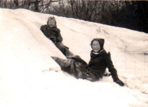 Rachel's sister, Joanne Thronson, and best friend, Diane Olson,  playing in the snow on the farm in the 1940s.