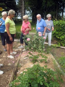Donna (center) gives a tour of her gardens. Photo by Jean Paschke
