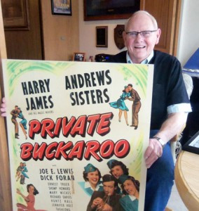 Tom Rockvam displays a lobby poster for Private Buckaroo, one of 17 movies the Andrews Sisters made. Others were Buck Privates with Abbott and Costello and Road to Rio with Bob Hope and Bing Crosby.   Photo by Chuck Sterling
