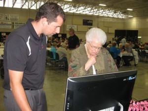 A TechTeam Technician helps a customer with Internet questions at a local customer appreciation event.  Contributed photo