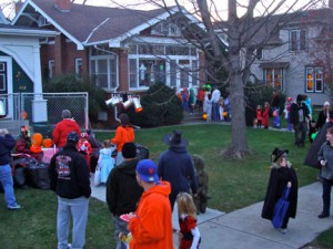 Young ghosts and goblins start lining up in the late afternoon for Halloween on State Street in New Ulm.  Contributed photo
