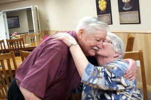 It is a family environment at The Village Cooperative in Alexandria. Above, Chuck Carlson receives an unexpected kiss from Violet, a tenant, in the community room. The community room is an active and vibrant room with meals, cards, games and an occasional kiss! Contributed photo