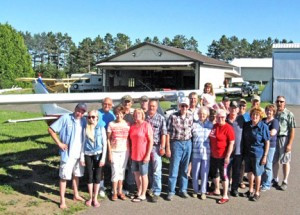 A group of active and retired pilots and their families gather during the warmer months at the Lucky 'Leven hangar belonging to Dennis and Kathy Kahlhamer at the Little Falls Airport. People of all ages come to talk planes over a potluck meal.   Photo by Jennie Zeitler