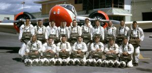 Jim Darr's Missoula Smokejumping group from 1966. Jim is in the back row, third from the right. The plane behind them is a Twin Beech that they jumped out of. Contributed photo