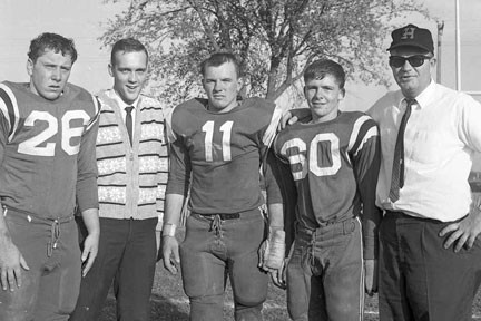 Hector's undefeated 1963 football team was led by all    conference players, #26 Jim (Todd) Macik, #11 Larry Radloff and #60 Eugene Buboltz. Don Lund was the assistant coach. Coach Hage is on the far right. Photo contributed