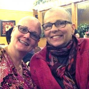Robin Ott and Suzy Vaught at a recent benefit. Ott shaved her head in support of others who have lost their hair during cancer treatments. Contributed photo