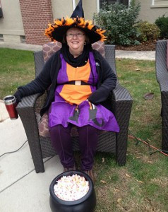 Jan Roeder relaxes in her witch costume before the mobs of kids start to show up. Contributed photo