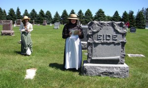 Bonnie Leraas talks about a local historical figure at a cemetery walk a few years ago. Leraas and her assisstant dressed in clothes from days gone by.             Photo contributed by Steve and Linda Ray.