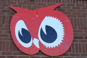 The iconic Red Owl  sign hangs on the building.