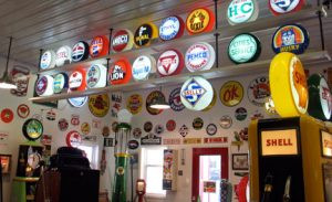 Kill's collection has several globes that once topped gas pumps. Each has an insignia of the oil company that sold the station its fuel. Photo by Carol Stender