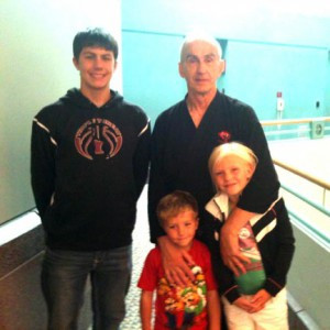 Ray Dinius with his grandchildren at Minneapolis Convention Center when he received his first-degree black belt in March. Contributed photo