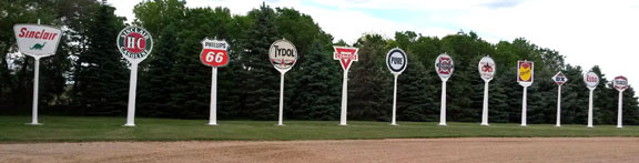 Fuel company signs line the driveway at Wally Kill's house outside of Morris. Contributed photo