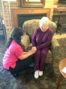 Park Manor, in Detroit Lakes, is one of the properties of the Schuett Companies. Here a resident shares a smile with a member of CompassionCare. Contributed photo