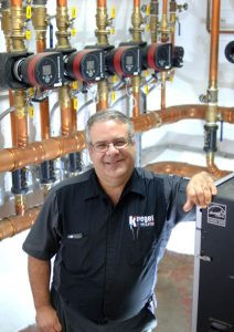 Kurt Koegel in the basement of Calvary Lutheran Church in Alexandria. Koegel revamped the entire boiler system in two weeks, giving the church even and reliable heat and earning himself an Excellence Award from Caleffi in 2014. Photo by Jim Palmer
