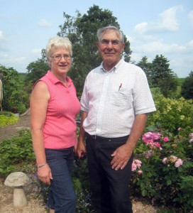 Donna and Dwight Christen, of Albany, at their farm near Albany. The Christens have filled about six acres of their land with  flowers and trees. The garden is being featured on Prairie Lawn and Garden, a PBS gardening show.  Photo by Jean Paschke