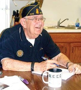 Larry Tillemans at his kitchen table in Sartell. Tillemans was a clerk during the World War II Nuremberg and Dachau War Trials                Photo by Scott Thoma