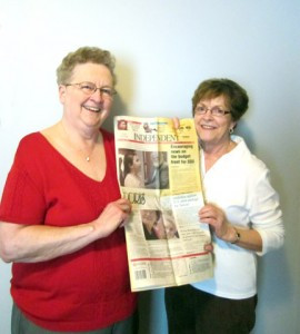 Doris Deml and Doris Brix looking at newspaper article about The Doris Group.