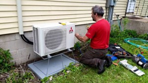 Pete Stoltenow, putting in ductless home system. Contributed photo