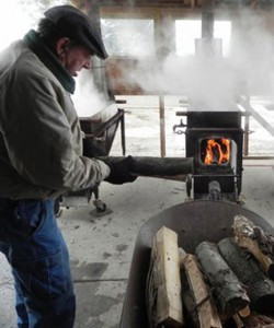 Three handmade stoves with custom pans evaporate the sap over wood fires. Contributed photo
