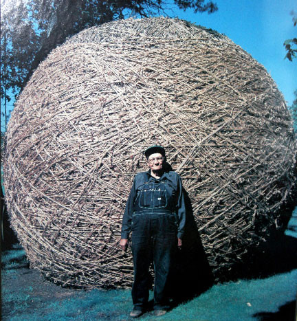 Frances A. Johnson standing in front of his record-setting twine ball.