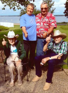 "Magnar and Oddny (front) share some ""thumbs up"" with Carolyn and Harvey Rust during their visit in August. The Norwegians learned a lot about modern farming, tried corn on the cob, and took a swim in Lake Minnewaska, among other things. They also got souvenir cowboy hats during their stay.   Contributed photo"
