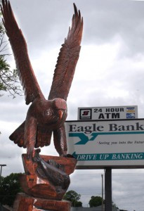 A carved eagle sits out front of the Eagle Bank in Glenwood. Photo by Jim Palmer.