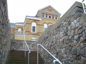 The retaining wall, façade and stairway on the front of the Todd County Courthouse in Long Prairie was completed by Frank Scharnoski in 1938 as part of the WPA program. Photo by Nancy Leasman