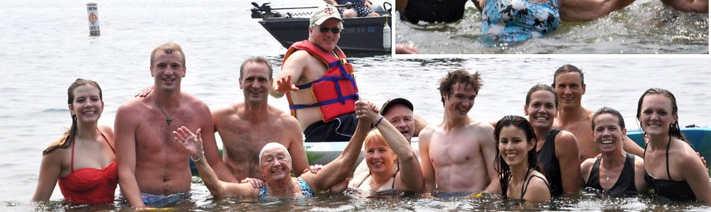 Sandy Abeler at the end of the swim, joined by some friends and family who swam along with her from one side of Cedar Lake to the other. Contributed photo