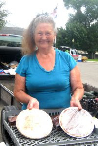 "Sonja Siemieniewski is affectionately called the ""pie lady."" Here she is with her last two pies at the Granite Falls Farmers Market.  Apple is always her best seller. Photo by Ida Kesteloot"