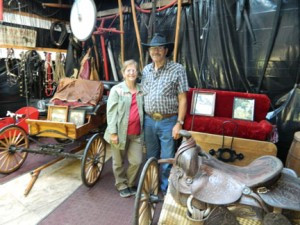 Marlene and Clay Van Horn with some of their western antique items at the Rockin C Horse Farm Family Entertainment. The farm is filled with unique items. Photo by Jen Bergerson