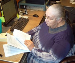 Dwyer edits a manuscript. Photos by Scott Thoma