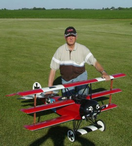 This replica model of a Fokker DR 1 triplane flown by the Red Baron in WW I was built by Dale Cordes (pictured with plane) and will be part of an exhibit of war artifacts displayed next year at the Brown County Historical Museum in New Ulm.  Contributed photo.