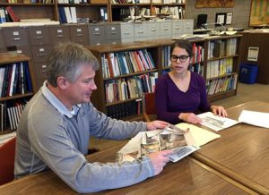 Stearns History Museum Archival Director Steven Penick talks with Stearns History Museum Archivist Jessie Storlien about the Stearns County Courthouse's terra cotta dome and clock dials featured on the building, which was completed in 1922. Photo by Frank Lee