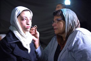 Mary Baumgarten, of Buffalo Lake, fits a girl in Kabul with a hearing aid. Contributed photo