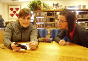 Jude Geske has questions for Connie Laing, librarian, at the Long Prairie branch of the Great River Regional Library. Geske was able to get some time with Laing using the Book-A-Librarian program. Photo by Nancy Potter