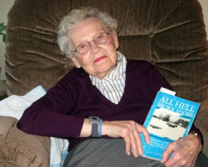 Sylvia Kuenzel, a resident at The Harbor, enjoys a relaxing day with a good book. Photo by Cathy Nelson