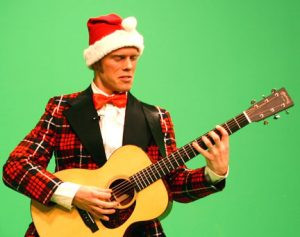 Jared Mason, decked out his Christmas best, performs a classic Chrsitmas tune. Mason is one of the  talented Medora entertainers in A Magical Medora Christmas. Contributed photo