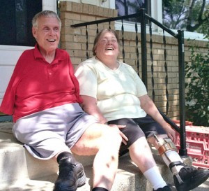 Paul and Maureen Pranghofer soak up some sun and share a laugh on the steps of their home in Golden Valley where they lead busy lives despite serious physical shortcomings. Photo by Chuck Sterling