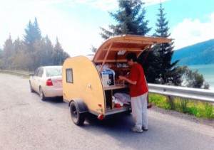 Gloria on the road with the teardrop, which opens up for storage in the back. Contributed photo