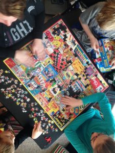 This year's puzzle featured vintage board game covers. Several family members worked on the 1,000-piece puzzle, which was completed in about a day and a half. Photo by Jim Palmer